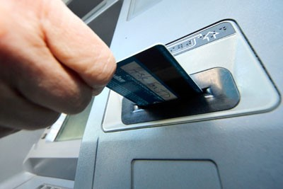 11 percent of Iraqis have bank accounts and 300 ATMs across the country