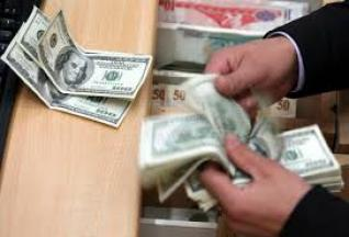 An increase in the price of the dollar in the Iraqi market